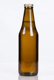 Classic plain brown glass beer bottle Stock Photos