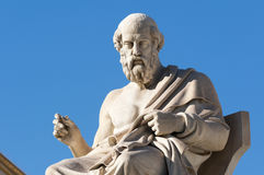 Classic Plato statue. Classic statues Plato sitting under blue sky Stock Photos