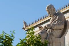 Classic Plato statue. Classic statues Plato sitting under blue sky Stock Photo