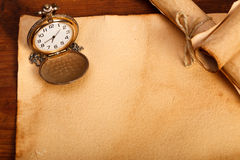 Classic pocket watch and old papers Stock Photography