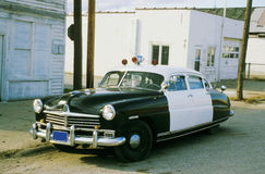 Classic Police Car. An old color photo of a 50's police car Stock Images