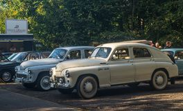 Classic Polish cars Warszawa. M-20 and sedan 223 behind parked during car show in Gdansk Oliwa, northern Poland Royalty Free Stock Image