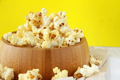 Classic popcorn  in a wooden cup Royalty Free Stock Images