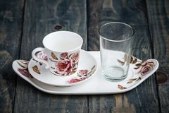 Classic Porcelain Turkish Coffee Cup with Tray and Glass stock photos