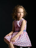 Classic portrait of a little girl in a pink dress with a smile o Stock Photo