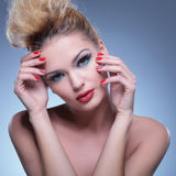 Classic pose of a beauty woman with hands on face Stock Photography