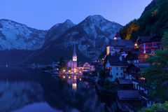 Classic postcard view of famous Hallstatt lakeside town in the Alps on a dusk in the summer, Salzkammergut region, Austria Stock Photo