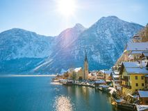 Classic postcard view of famous Hallstatt lakeside town in the Alps moutain ship on a beautiful cold sunny day with blue sky and c royalty free stock image