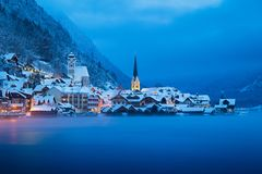 Hallstatt in mystic twilight in winter, Salzkammergut, Austria. Classic postcard view of famous Hallstatt lakeside town in the Alps in mystic twilight during Stock Image