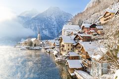 Classic view of Hallstatt with ship in winter, Salzkammergut, Au. Classic postcard view of famous Hallstatt lakeside town in the Alps with passenger ship on a Stock Image