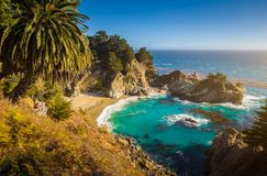 McWay Falls at sunset, Big Sur, California, USA. Classic postcard view of famous McWay Falls in scenic golden evening light at sunset on a beautiful sunny day royalty free stock image