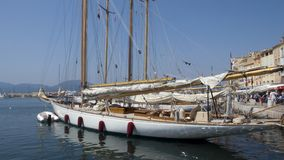 Classic at quai. Classic sailing yacht designed by William Fife, moored at the keys of St-Tropez Stock Image