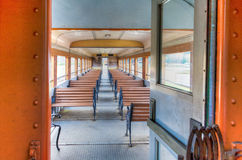 Classic railroad passenger car. Interior of antique economy class railroad passenger car with bench seating Royalty Free Stock Photos