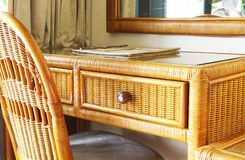 Classic Rattan Writing Desk and Chair. Beautiful and classic rattan writing desk in a room Royalty Free Stock Photo