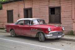 Classic red american car in Guantanamo, Cuba. Cuban red taxi parked in Jamaica, Guantanamo, Cuba royalty free stock photo