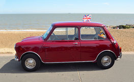 Classic Red Austin Mini motor car parked on  Felixstowe seafront promenade. Stock Photo