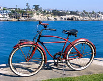 Classic red bicycle at park. Classic red bicycle at an ocean side park in California Royalty Free Stock Photography