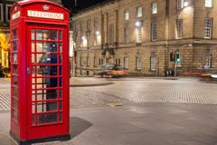 Classic red British telephone box, night scene Royalty Free Stock Photo