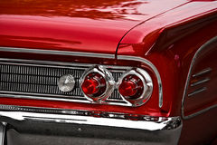 Classic Red Car. Taillights of a classic red car Royalty Free Stock Image