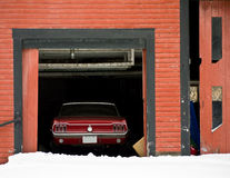 Classic Red Car in Barn Stock Images