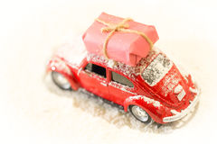 Classic red car deliverling Santa Clause presents in snowy weath Royalty Free Stock Image