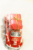 Classic red car deliverling Santa Clause presents in snowy weath Royalty Free Stock Photo