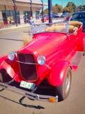 Classic red car. A classic car in a car park Stock Photo