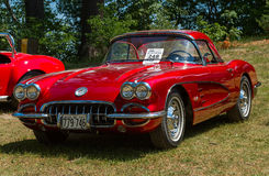 Classic red Corvette car. Vintage red Corvette car on a grassy meadow Royalty Free Stock Images