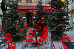 Classic red fittings of alfresco bistro at Christmas Royalty Free Stock Photography