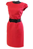Classic red dress with black belt on a mannequin. On a white background isolated Stock Photo
