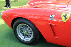 Classic red italian racing car. Classic 1960s red Italian racing car details. 1960 Ferrari 250 GT SWB TDF Competizione racer outdoors on a sunny day Stock Photos