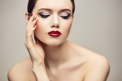 Classic red lips girl looking down Royalty Free Stock Images