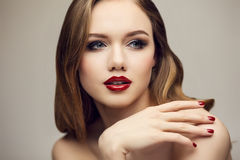 Classic red lips girl looking to right Stock Images