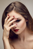 Classic red lips girl touching forehead Stock Photo