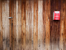 Classic red mail box on vintage wood Stock Image