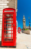 Classic red phone booth of London in front of Big Ben Stock Photography