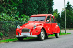 Classic red retro car. French red Citroen 2 cv parked in a street Royalty Free Stock Photos