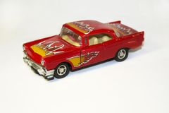 Classic red retro toy car with flame pattern on white background. Close-up stock photo