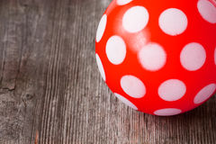 Classic red rubber ball with white dots Royalty Free Stock Photo