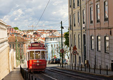 Classic red tram of Lisbon. Historic classic red tram of Lisbon built partially of wood navigating, narrow, winding streets, Portugal Stock Photo