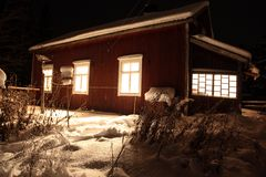 Classic Red wooden Finnish house in winter Royalty Free Stock Photography