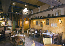 Classic restaurant interior. A stylish restaurant interior, the room is rustic, beautifully decorated, plenty of tasteful details all around the place Stock Images