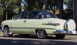 Classic Restored Antique Crown Victoria Car. Classic restored light green Crown Victoria car Stock Image