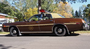 Classic Restored Brown Plymouth Sabre. Peace officer's car Royalty Free Stock Photos