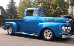 Classic Restored Half Ton Truck. Classic restored blue half ton truck with running boards parked on street in downtown Edmonton Royalty Free Stock Photography