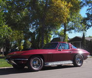 Classic Restored Red Chevrolet Corvette. Parked on street Royalty Free Stock Image
