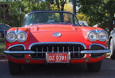 Classic Restored Red And White Corvette Convertible. In parking lot Stock Photo