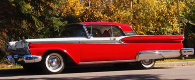 Classic Restored Red And White Ford Fairlane Skyliner. In park Royalty Free Stock Photos