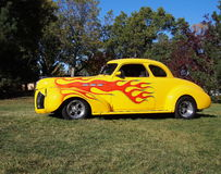 Classic Restored Yellow Car With Flame Detail Royalty Free Stock Photos