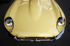 Classic retro car hood. Isolated yellow classic retro car hood Stock Images